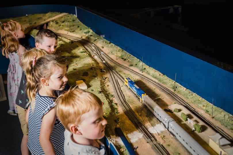 young children watching at train run on the tracks of the miniature railway at the Bathurst Rail Museum